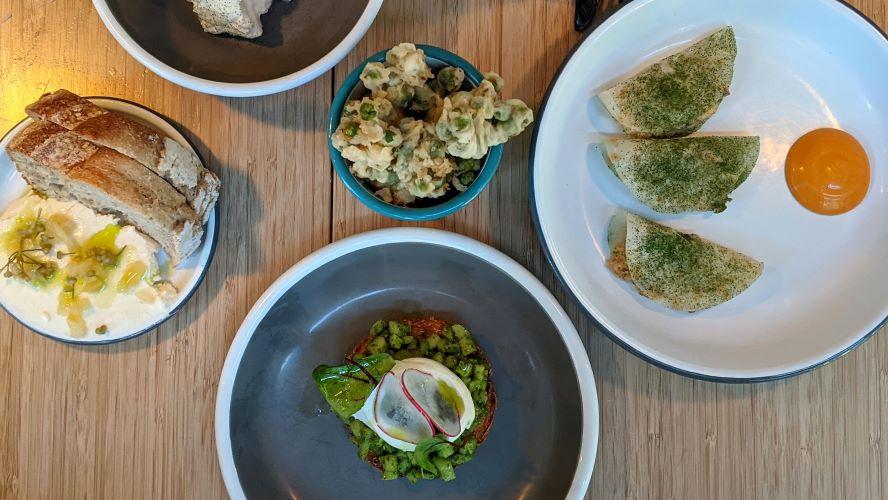 Oleg Pelmeni's mackerel tacos (right), pea tempura (top) and draniki (bottom)